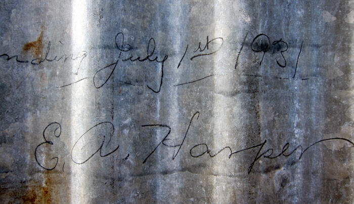 Signature on the front wall of the cabin, signed by the builder Amby Harper in 1931